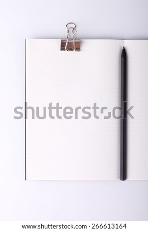 open blank notebook with paper clip and pencil - stock photo