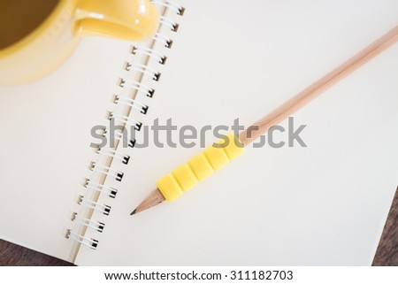 Open blank notebook with pencil, stock photo