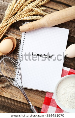 Open blank recipe book on brown wooden background - stock photo