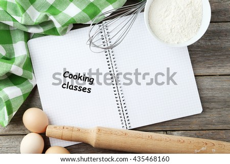 Open blank recipe book on grey wooden background - stock photo