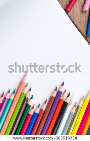 Open Blank Sketch book with Chalk colored and Colour pencils - stock photo