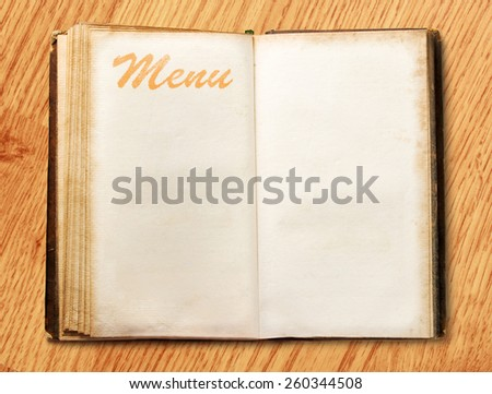 Open blank vintage menu book on background - stock photo