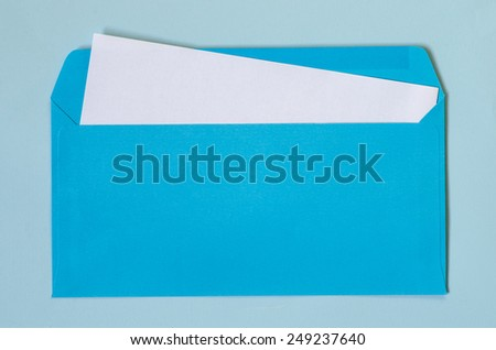 open blue envelope with  blank paper on blue background