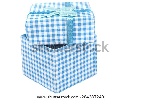 Open Blue jewelry ring cardboard box with pattern and rIbbon isolated on white background - stock photo