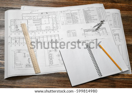 Building permit stock images royalty free images vectors open blueprints on wooden table background with a pencil a ruler and compasses lying beside malvernweather Choice Image