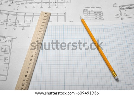 Open blueprints on wooden table background stock photo download now open blueprints on wooden table background with a pencil and a ruler lying beside engineering malvernweather Image collections