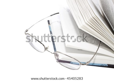Open Book and Glasses isolated on white