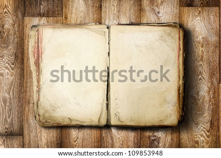 Open Book blank on old wooden background - stock photo