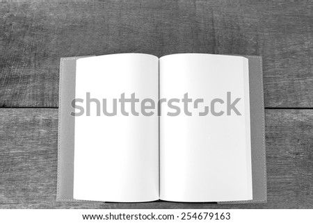 Open Book blank on wood background