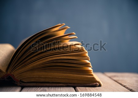 Open book close-up on a background of school board - stock photo