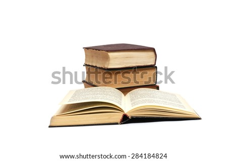 Open book compared to other books - stock photo