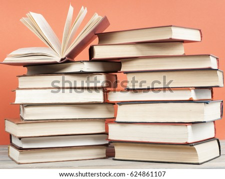 Open book, hardback books on wooden table. Back to school. Education concept.