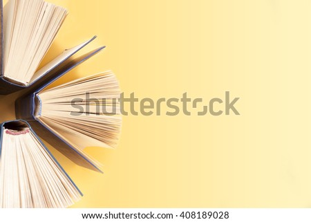 Open book, hardback books on wooden table. Education background. Back to school. Copy space for text. - stock photo