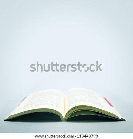 Open Book in a Grey Background