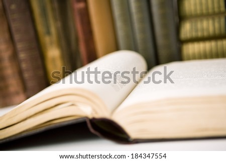 Open book in  Library on table - stock photo