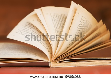 Open book in retro style on wooden background. Education concepts