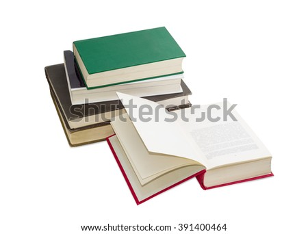 Open book in the red cover on the background of the stack of other books different formats and cover design on a light background