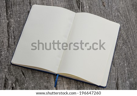 Open book in wooden background - stock photo