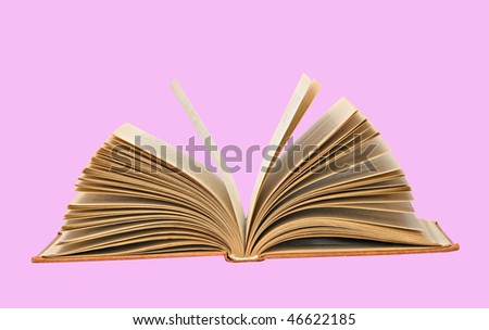 Open book  isolated on pink background