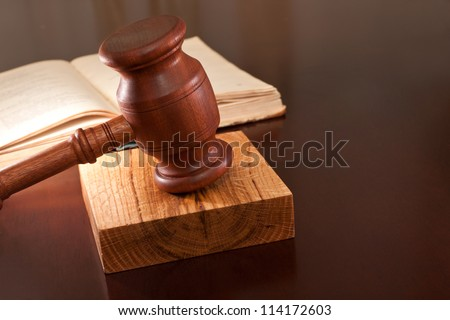 Open book of laws and gavel on the table