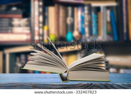 Open book on a bookshelf