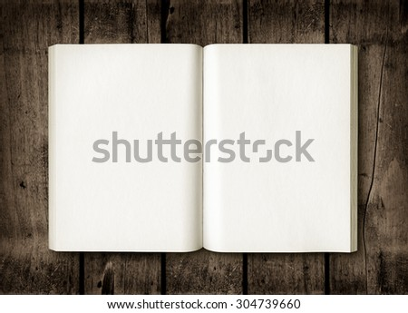 Open book on a dark wood table. Mockup