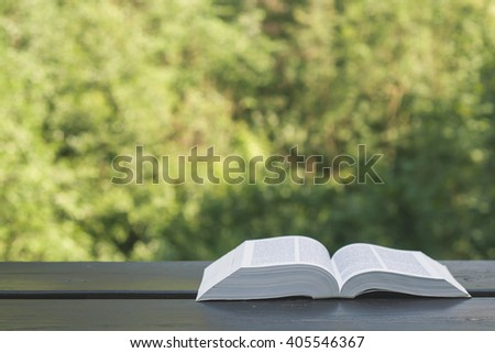 open book on a garden wooden table