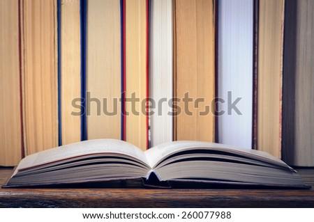 Open book on a shelf - stock photo
