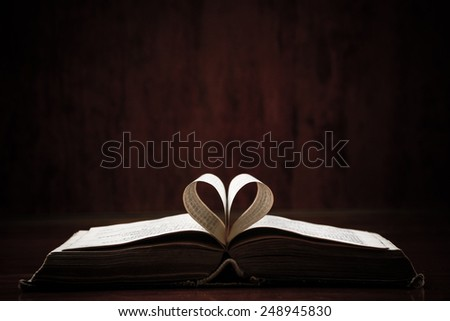 Open book on a table. Ideal for a text messages. - stock photo