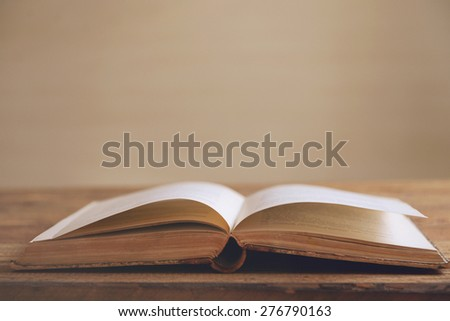 open book on a wooden background