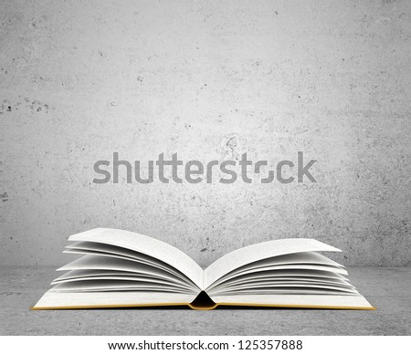 open book on concrete background - stock photo