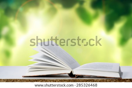 Open book on natural background - stock photo