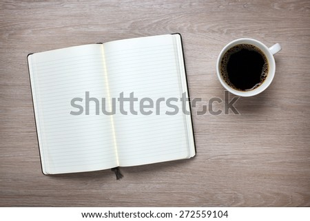 Open book on office desk - stock photo