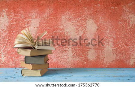open book on red background, free copy space - stock photo