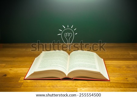 open book on table with light bulb for idea concept