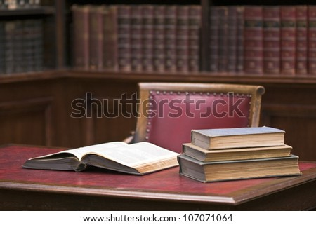 Open book on the table. Educational environment. Selective focus on opened book - stock photo
