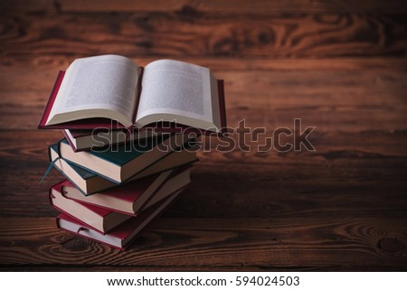 open book on top pile books stock photo royalty free 594024503