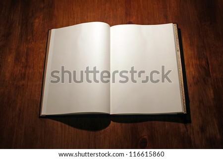 Open book on white - stock photo