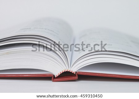 Open book on white background, Some part. Close-up, selective and soft focus.