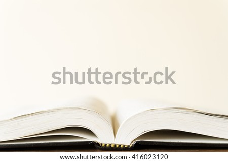 open book on white background with copyspace