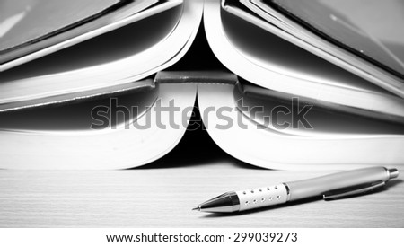 open book on wood background black and white color tone style