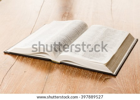 open book on wooden background
