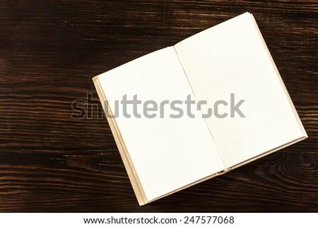 Open Book On Wooden Desk./Open Book On Wooden Desk. - stock photo