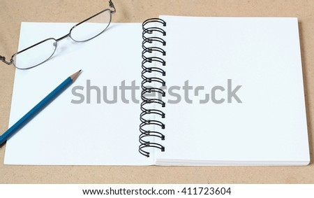 Open book on wooden table - stock photo