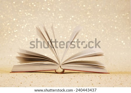 Open book, Open book on the sparkly vintage golden background