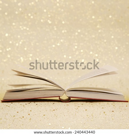 Open book, Open book on the sparkly vintage golden background  - stock photo