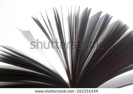 Open book, pages fluttering. Fantasy, imagination, education concept. Black and white. - stock photo