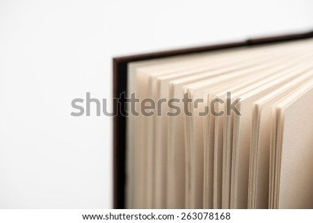 Open book pages in white background, close-up. Open book.