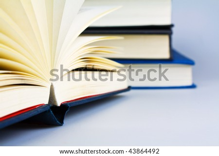open book shallow dof focus on the open book - stock photo
