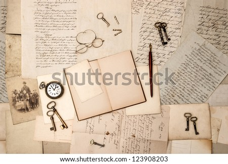 open book, vintage accessories, old letters and post cards. nostalgic background